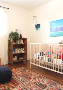 nursery book shelf and rug and crib